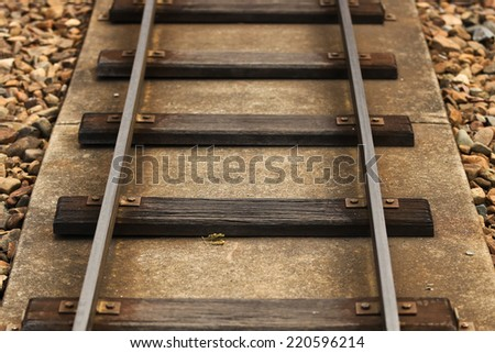 Railroad on Concrete with Rocks - stock photo