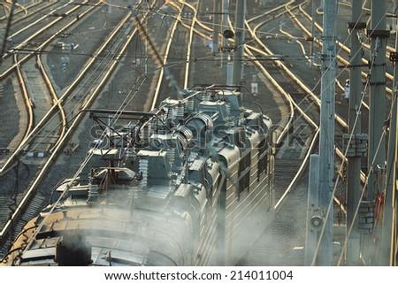 railroad rails path train station wire - stock photo