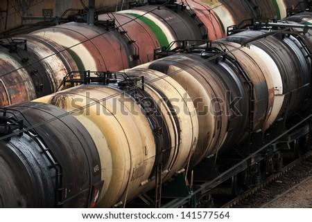 Railroad scene with trains of oil tanks - stock photo