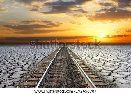railroad sunset. land in the cracks