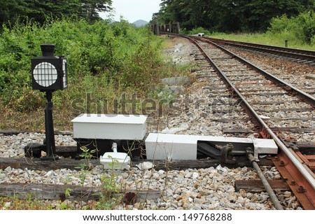 railroad switch in the urban station of Thailand.  - stock photo