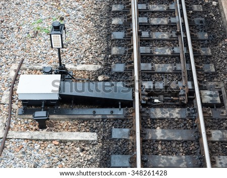 Railroad switch of the old train station. - stock photo