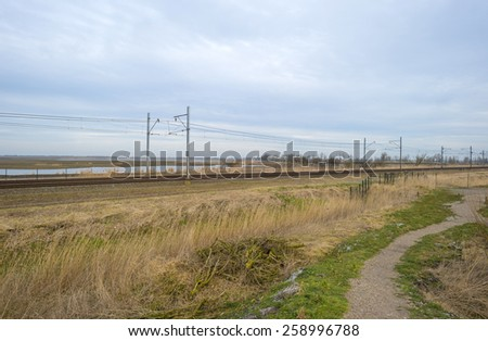 Railroad through the countryside in winter - stock photo