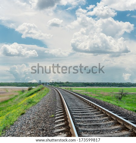 railroad to horizon and cloudy sky