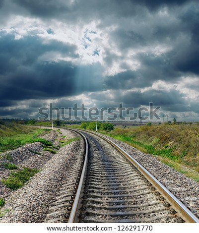 railroad to horizon and dramatic sky