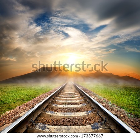 Railroad to the mountains at beautiful sunrise