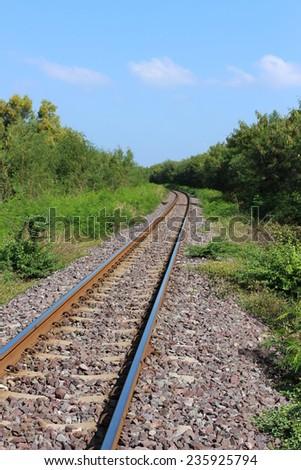 railroad track landscape tree sky background - stock photo
