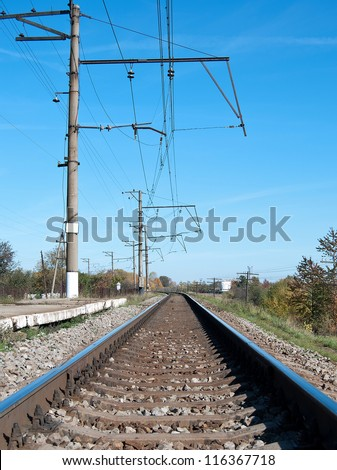 railroad track vanishing into the distance - stock photo