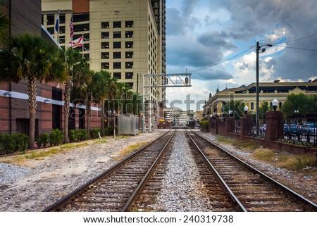 Railroad tracks and buildings in Orlando, Florida. - stock photo
