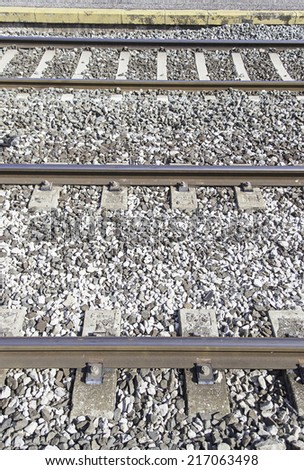 Railroad tracks at a station, a detail of train tracks, land transport - stock photo