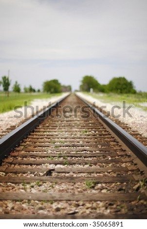 Railroad tracks in a rural town leading into infinity