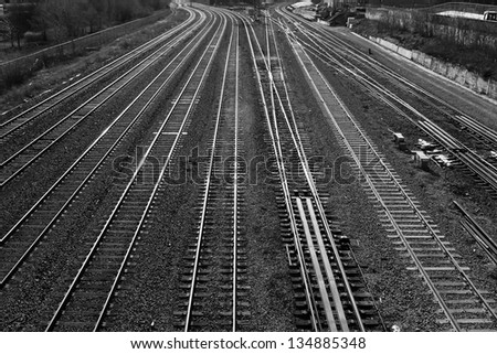 Railroad tracks in black and white - stock photo