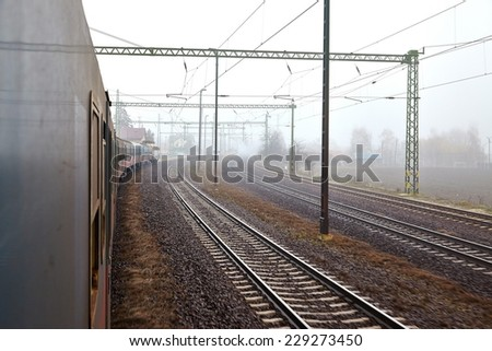 Railroad tracks in the fog - stock photo