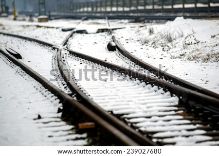 Railroad tracks in the snow at winter - stock photo