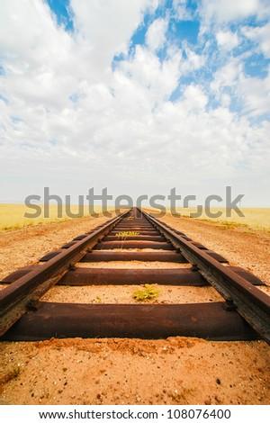 Railroad tracks leading to nowhere - stock photo