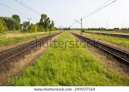 railroad tracks on a beautiful sunny day - stock photo