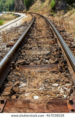 Railroad tracks on the old worn wooden sleepers require urgent repair. The narrow-gauge railway along the ridge.