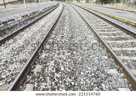 Railroad tracks, roads in some detail a station, overland transport - stock photo