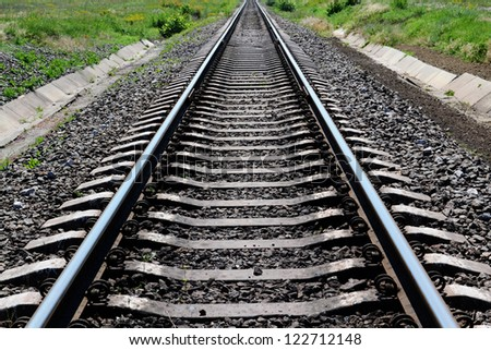 Railroad tracks stretching into the distance - stock photo