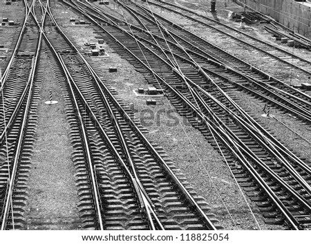 Railroad tracks. Top view. Black and white image, monochrome. - stock photo