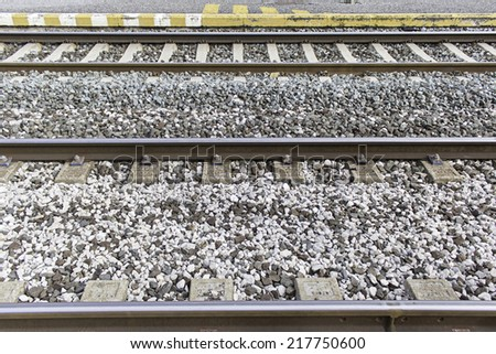 Railroad tracks with stones and rails, transport - stock photo
