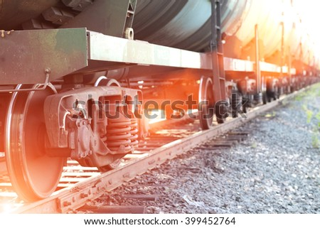 Railroad train of black tanker cars transporting crude oil on the tracks, with instagram style filter - stock photo