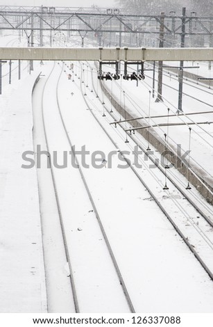 railroad with snow landscape - stock photo