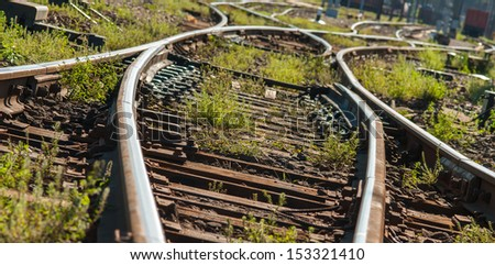 Railroads track points with Shallow Depth of Field. - stock photo