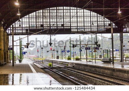 rails and signal lamps  in historic Wiesbaden central train station - stock photo