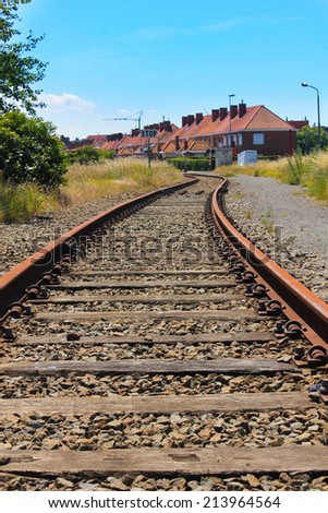 Rails in a town of Belgium - stock photo