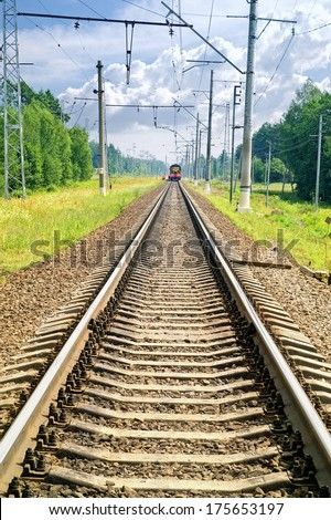 Rails of railway leaving afar and locomotive