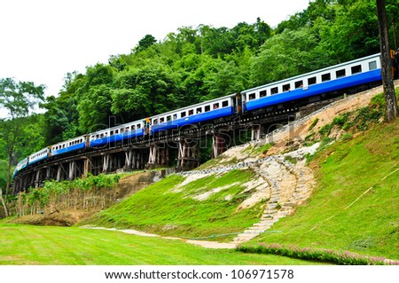 Rails parallel to the mountains is beautiful view on Thai Railway. - stock photo
