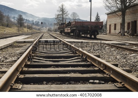 rails With small station and platform on background