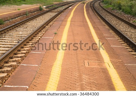 Railway and platform with yellow painted lines.