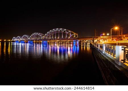 Railway bridge at night in Riga, Latvia - stock photo