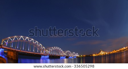 Railway bridge at night , Riga, Latvia - stock photo