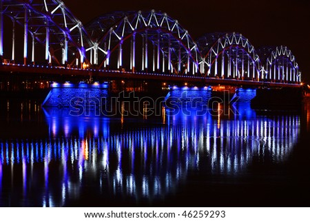 Railway bridge in Riga at night