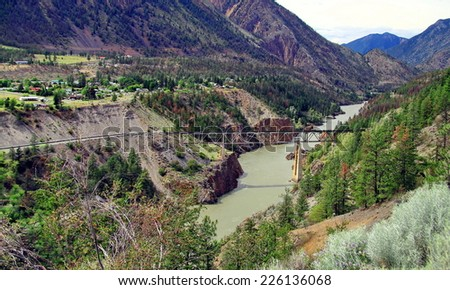 Railway bridge in the mountains in Lillooet town - stock photo