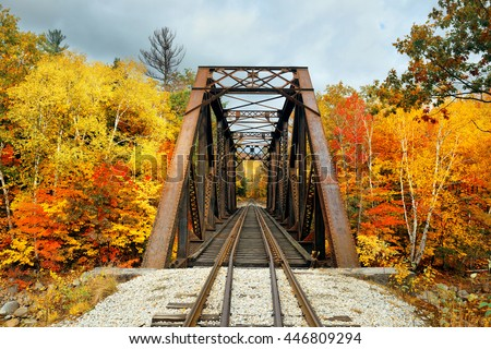 Railway bridge in woods with colorful foliage, White Mountain, NH