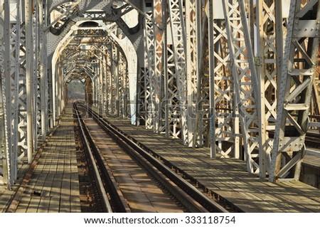 Railway bridge. Torah, steel construction. Crossing the river. - stock photo