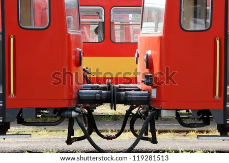 Railway carriages in the railway station. Symmetrical image. Train type is Bzmot without any trademark.
