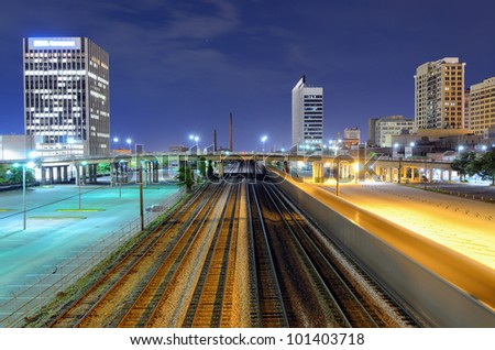 Railway in cutting through downtown Birmingham, Alabama, USA. - stock photo