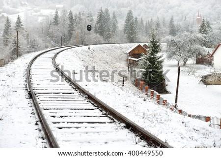 Railway in snow. Winter landscape with empty rail tracks - stock photo
