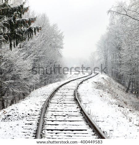 Railway in snow. Winter landscape with empty rail tracks