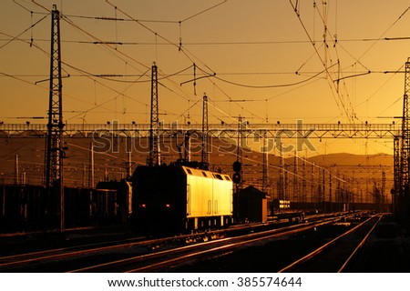 Railway in the sunset red background