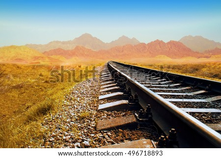 Railway in the Valley. Railway in the desert. railroad through the mountains. Transportation theme. Wild path for train