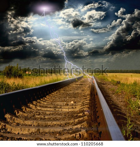 railway in to the storm with lightnings - stock photo