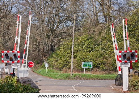 Railway level crossing at Eggesford in mid Devon UK on the picturesque line that runs through the heart of the county linking Exeter in the south with Barnstaple in the north - stock photo