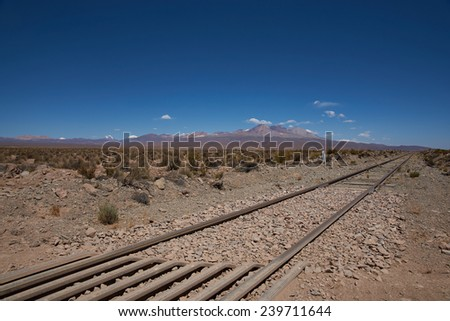 Railway line running across the high altitude Altiplano of northern Chile. The railway connects Bolivia with the Port of Arica on the Pacific Coast of Chile. - stock photo