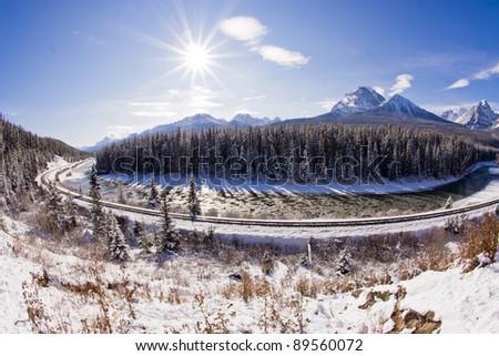 Railway line through the winter wonderland of the Canadian Rockies - stock photo